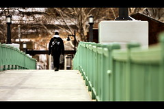 Walking Away (Phil Roeder) Tags: bridge green student crossing universityofiowa canon70200f28 canonef70200f28 canon70200f28lll