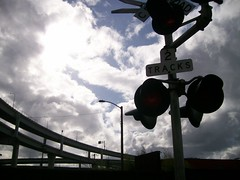 Clouds, highway ramps, railroad signal