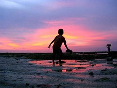 Bali...2011 (daaynos) Tags: boy sunset sea sky bali woman beach water silhouette clouds reflections sand child horizon lembongan beautifulbali