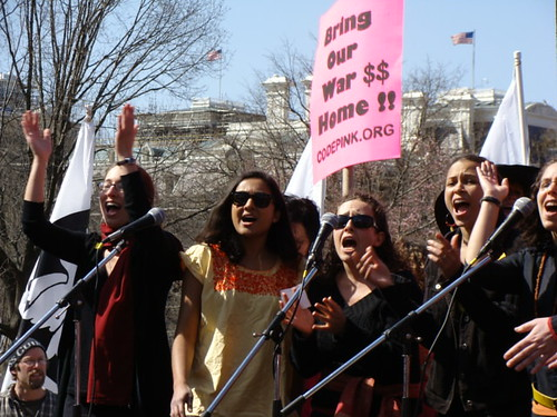 Women's a capella group Songrise performs at CODEPINK 's Women Say No to War Rally