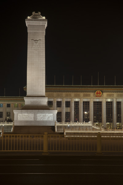 A tower monument and governmental building at Tiananmen Square.  During the night tourists are not allowed onto the square so all pictures were taken from across the road.