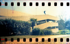 Johan 5-0 (bertwootton) Tags: film 35mm gold holga lomography skateboarding kodak garage parking gainesville roger 50 skateboards johan frontside sprockets 36mm stuckey
