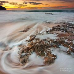 Streams ( Bakio ) (saki_axat) Tags: ocean sunset sea sky orange seascape motion beach nature water clouds canon landscape eos coast sand rocks waves tokina coastal filters bizkaia 1224 bakio orillas 50d gnd8 canonikos