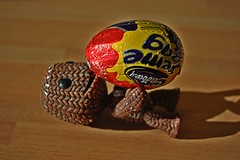 Sackboy wants a Cream Egg (DaveJC90) Tags: game macro closeup eating chocolate sony egg eat figure hungry playstation cadburys ps3 playstation3 creamegg littlebigplanet sackboy