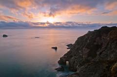 Bixby Bridge Outlook (andreaskoeberl) Tags: ocean california longexposure light sunset cliff seascape colors northerncalifornia clouds coast nikon rocks pacific bigsur shore bixbybridge ndfilter 1685 d7000 nikon1685 nikond7000 andreaskoeberl