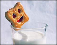 Smiling despite the circumstances :) (ngeles - The End - Good Bye) Tags: smile canon milk cookie biscuit snack leche merienda sonreir galleta 450d airamselegna