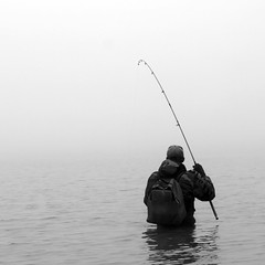Fisherman standing in water trout fishing (!.Keesssss.!) Tags: winter people reflection nature water weather fog standing square outdoors photography fishing fisherman holding solitude day adult belgium backpack hobbies anticipation copyspace rearview youngadult adultsonly oneperson gettyimages fishingrod royaltyfree casualclothing colorimage leisureactivity onlymen oneyoungmanonly onemanonly waistup coldtemperature 2024years waistdeepinwater theflickrcollection keessmans 200ksgetty