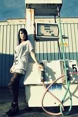 Jem (Muta Takes A Picture) Tags: old woman girl lady vintage pose hair model decay tights gas pump aged jem petrol decayed gaspump deisel
