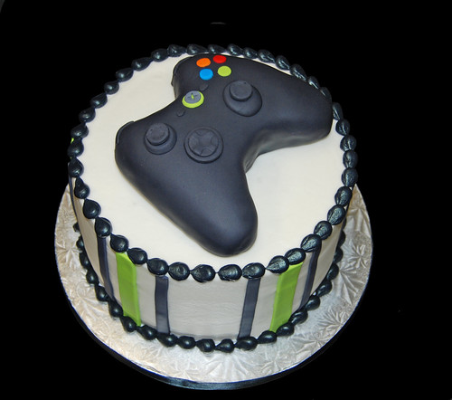 Black and neon green birthday cake topped with a video game controller for an XBOX themed party