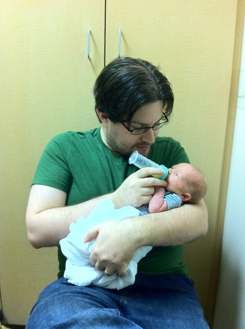 Had a very lengthy visit with a lactation consultant. Rob got to feed the baby some liquid gold with his first bottle ever.