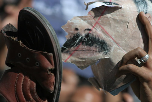 This protester is beating a photo of Yemen's President Ali Abdullah Saleh with a shoe. This is a sign of disrespect in the Arab world