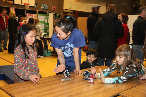 Anna demonstrating robots to the elementary school students