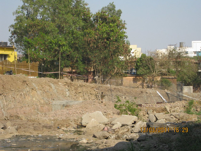Who is dumping debris in the river RamNadi?