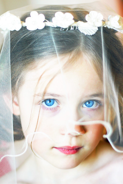Beauty is being 7 and getting to try on your moms wedding veil.