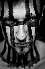 feel the dark side... (RiccardoDelfanti) Tags: blackandwhite bw white black dark beard blackwhite eyes stripes side feel  evil tribal bn bianco nero biancoenero riccardodelfanti riccardodelfanti