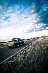 gone gone gone (Joel H Stewart) Tags: road blue arizona sky motion grass clouds truck horizon pickup gone robertplant alisonkrauss navajocounty