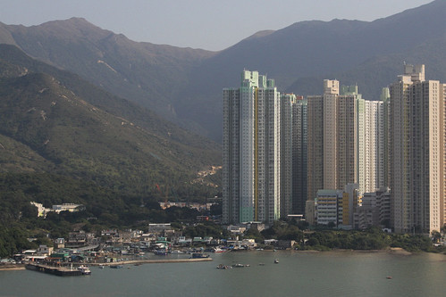 Modern apartment blocks tower above the old fishing village on Tung Chung Bay