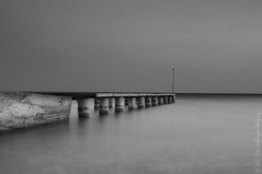 The last gate of serenity. (B&W) (Manos Eleftheroglou (Photography)) Tags: longexposure light sunset sea sky bw white seascape black film beach nature water beautiful island greek pier spring nikon europe long exposure day sundown aegean scenic hellas tranquility scene east greece harmony serenity griechenland soe samos waterscape pythagorion pythagorio 2011 supershot photographyrocks mywinners abigfave   dorissa platinumphoto d5000 anawesomeshot  aplusphoto potokaki  flickraward  platinumheartaward betterthangood goldstaraward  nikonflickraward artofimages nikond5000 mygearandmepremium mygearandmebronze mygearandmesilver mygearandmegold mygearandmeplatinum blinkagain makisamos bestofblinkwinner peregrino27blackwhite