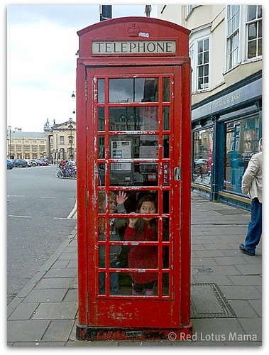 Princess D and Terror trapped in a red phone booth in Oxford. #UK2011trip