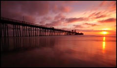 Sunset at the Oceanside Pier (Explored) (canon60dslr) Tags: ocean california sky water misty clouds evening pier hues oceanside fiery silky suset oceansidepier thechallengefactory
