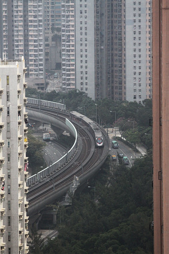 Train weaving between apartment towers