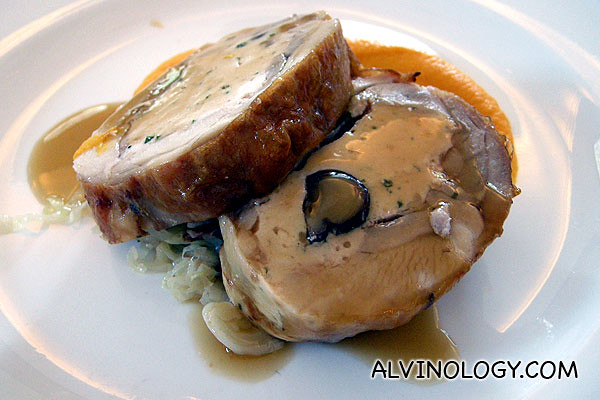 De-boned chicken with chestnut stuffing served with carrot puree and braised cabbage