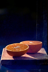 a glimpse of winter sun (lisamurray) Tags: blue stilllife orange fruit textured winterlight tamron90mm inthegarden nikond90 texturebylesbrumes