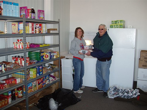 Earth Team Volunteer Robert Mosier (right) delivers donated deer meet to Melinda Kendall at a food pantry in Kiowa County Kansas. Mosier was recently named as NRCS' top volunteer for 2011.