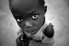 Lendu girl - Gety - DR Congo (C.Stramba-Badiali) Tags: poverty voyage travel portrait people bw face look rural person eyes village child expression african energie culture yeux human sharing conflict blackpeople remote tradition fighting enfant glance dignity humanbeing complicity drc homme bunia visage intensity regard swahili zaire complicit displaced partage rdc blackskin displacedperson congolese lookingatcamera centralafrica echange intensit lingala monuc rpubliquedmocratiqueducongo ethnie congokinshasa ethnicgroup peaunoire afriquecentrale canon5dmkii forgottenconflict strambabadiali christophestrambabadiali ituridistrict francophonecountry