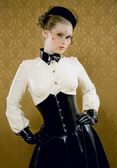 Latex Clad Lady [info request] (Fetish Art Identification Search) Tags: white black glamour veil skirt rubber blouse gloves latex corset gummi blackhat request whiteshirt blackgloves blackskirt pleatedskirt blackcorset blackveil blackcollar silverbuttons