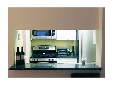 Pass Through Kitchen at Apt 3J Wellington Tower by Bid on The City
