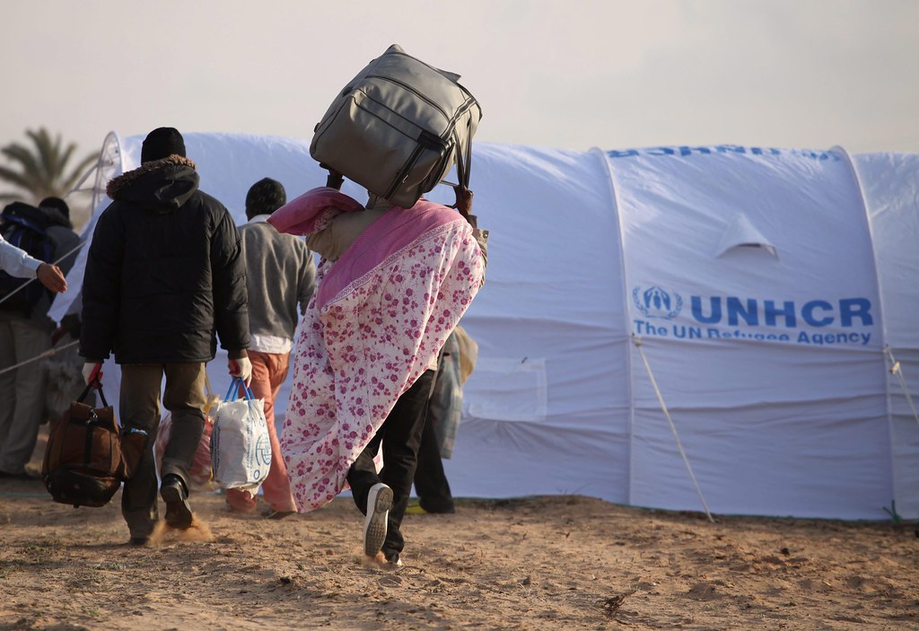 UNHCR News Story: Thousands of people flown home from Tunisia as evacuation begins
