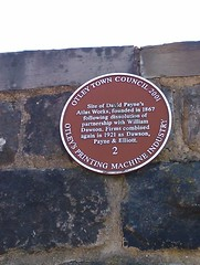 Photo of David Payne and Atlas Works brown plaque