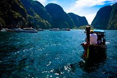 The Old Against The New (yoononn) Tags: new old blue sea beach thailand boats island boat skies maya snorkeling clear krabi sampan speedboats
