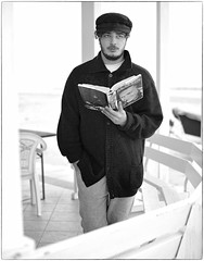 The Importance of Reading (Steve Lundqvist) Tags: people mcqueen steve book reading hat boy man monochrome bw black white portrait ritratto cardigan libro nikon nikkor