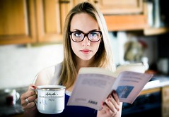 A coffee and a book (BlueMaury) Tags: book nerd glasses girl blonde breakfast kitchen student morning eyes coffee cup