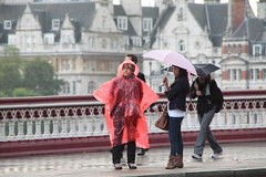 Red rainmac & pink umbrella (Ian Press Photography) Tags: street bridge pink red summer people london wet rain umbrella person mac candid streetphotography blackfriars rainmac