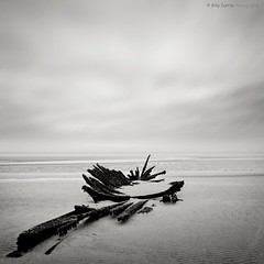 Wrecked! (Billy Currie) Tags: ocean old cloud texture abandoned beach dark grey mono scotland wooden sand ancient ship tide shipwreck bones rotten sunk wreck rg tidal sinking coastuk welcomeuk