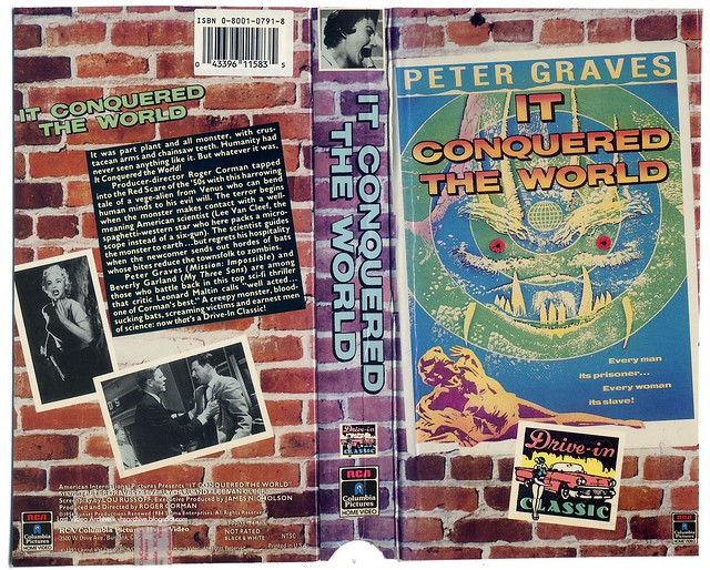 In Conquered the World (VHS Box Art)