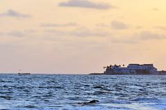 Elmina Fort from Cape Coast, Ghana (MJ Reilly) Tags: africa sea sky sun castle boat fishing nikon fort atlantic ghana shore westafrica afrika atlanticocean slave capecoast elmina d90 elminabay