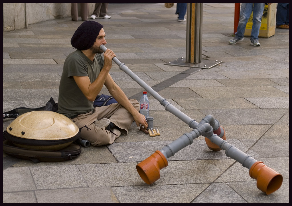 Köln / Cologne (Germany): Young man playing a self-made didgeridoo...
