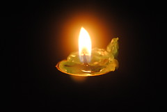 Bright green candle with glowing flame (amazing_tina) Tags: light happy flame wax cheerful matches shining warming yellowflame greencandle brightcandle glowingflame