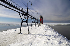 South Haven Lighthouse (Tim Kornoelje) Tags: lakemichigan southhaven lighthouse ice frozen michigan pier channel winter january 2010 nature park outdoors snow cold historical historic scenic scenery travel tourism structure landscape landmark beacon navigation nautical beautiful america midwest usa red clouds sky water lake unitedstates greatlakes westernmichigan