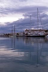 Mastiles reflejados en el mar (ibzsierra) Tags: sea sky cloud mer port canon puerto boat mar mare barco ship harbour vessel ibiza cielo 7d eivissa bateau baleares nuboso