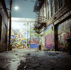 Load of Fun Alley (Daniel Regner) Tags: street city light urban snow cold art tlr wet beautiful night dark lens fun photography graffiti coast reflex amazing alley long exposure paint artist kodak shots snowy daniel c feel twin maryland baltimore spray east rainy designs medium format lit february dim raining load portra yashica loads 2011 160nc regner