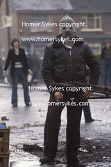IRISH REPUBLICAN ARMY SOLDIER YOUNG ADULT RIOTER RIOTS BELFAST 1980S UK (Homer Sykes) Tags: uk ireland riot catholic mask teenagers teens belfast 80s hood northernireland british ira northern society 1980s troubles the gbr rioting thetroubles northernirelanduk archivestock