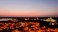 Sunset over the Magic Kingdom (Peter E. Lee) Tags: longexposure winter sunset landscape orlando parkinglot glow florida dusk wide disney fl wdw waltdisneyworld magickingdom goldenhour spacemountain dvc contemporaryresort cinderellacastle 2011 sevenseaslagoon disneyvacationclub disneyphotochallenge baylaketower topoftheworldlounge