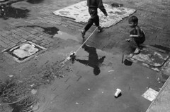 ... (firdaus usman) Tags: bw film station playground kids analog children indonesia ui documentary human push blacknwhite nikonf 800 interest kereta 2011 sunny16 depok humaniora earthasia nikkor28mmf28ai ultrafine400 statsiun