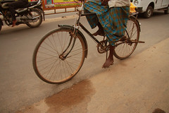 bike on the road (ivana rambaldi) Tags: people woman india man men hands women asia prayer praying poor kerala sacred madurai tamil kochi tamilnadu trivandrum kanyakumari southindia sacro