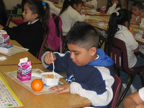 First grader at Reavis Elementary School, a Chicago Public School, eats breakfast in the classroom. (School Breakfast Week, March 2009)